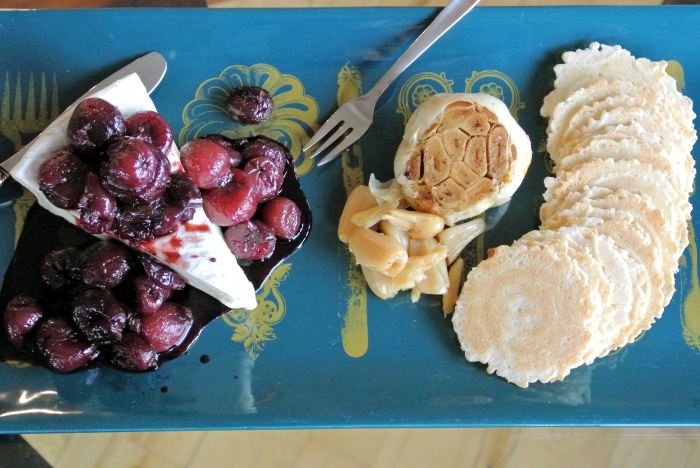 Brie with Roasted Garlic and Balsamic Cherries